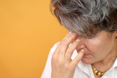 Horrible day. Painful and sad moment for an older woman Stock Photos