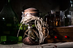 Horrible dead creature with bulging eyes inside jar between glas Stock Images