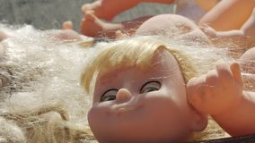 Horrible dolls heads. Horrible heads and other parts of dolls bodies stock video footage