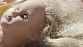 Horrible dolls heads. Horrible heads and other parts of dolls bodies stock footage