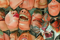 Horrible faces. Masks at an alley stall in Hong Kong with really ugly faces Royalty Free Stock Photo