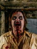 Horrible hungry zombie Stock Photo