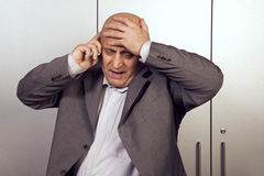 Horrible messages, businessman. Horrible messages from the phone stock images