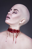 Horrible scary zombie woman. Halloween makeup. Stock Photo