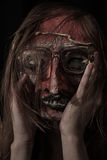 Horrible theatrical mask dressed In Glasses. Closeup Stock Images