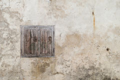 Horrible window on old cracked wall. Found in a soi downtown Bangkok, Thailand royalty free stock photos