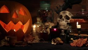 Halloween still life with pumpkins and skull stock footage