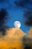 Horrific Moon. A horrific picture of a moon in a stormy sky full of clouds Stock Photography