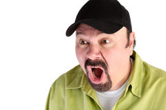 Horrified man in baseball cap shouting Royalty Free Stock Photography