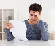 Horrified man reading a document Stock Image