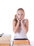 Horrified schoolgirl with pile of books Royalty Free Stock Photos