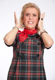 Horrified senior woman Stock Images