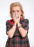 Horrified senior woman Royalty Free Stock Images