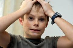 Horrified teenager boy Stock Image