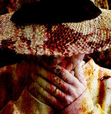 Horrified woman. Textured portrait of a woman in a hat, overlay texture resembles blood Royalty Free Stock Photography