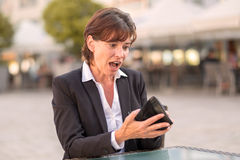 Horrified woman unable to pay her bill Stock Image
