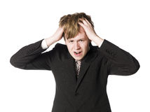 Horrified young man. Towards white background Royalty Free Stock Photography