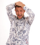 Horrified young man Royalty Free Stock Photo