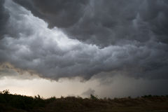 Horrifine clouds moving ahead of storm. Horrifine clouds moving ahead of the storm being situated close to the ground Royalty Free Stock Photos