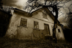 Horror background - the abandoned old creepy house Stock Photography