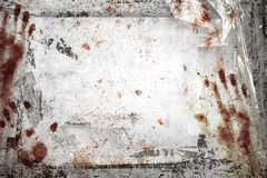 Horror background. With grungy frame, bloody handprints, remains of scotch tape and cellophane. Fully . It can be used as a party invitation, food menu, poster Royalty Free Stock Photos