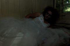 Horror bride in bed. Creepy bride in creepy devastated room stock photos