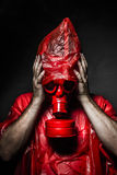 Horror concept, man with red gas mask. Stock Images