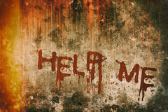 Horror Crime Concept. Help Message on Bloody Background Wall Royalty Free Stock Photography