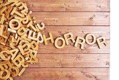 Horror da palavra feito com letras de madeira Imagens de Stock