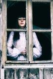 Horror dama przy okno Fotografia Stock