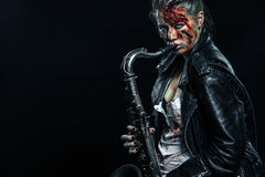Horror. Dead musician, scary zombie playing on saxophone in halloween . Stock Photography