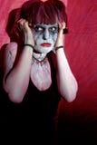 Horror del zombi de la muchacha contra la pared roja Imágenes de archivo libres de regalías