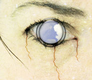 Horror eye Cd Cover Art. Photomanipulation of my eye with a cloud as a focus point Royalty Free Stock Photo