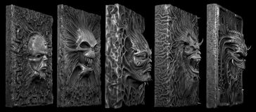 Horror faces. On slabs in 3D bas relief stock photos