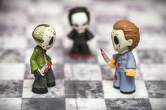 Horror Game. Funny Toys on Chess Board Stock Photos