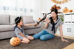 Horror girl play the killing game with her mother Royalty Free Stock Image