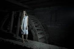 Horror girl in white dress Stock Images