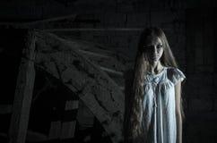 Horror girl in white dress Stock Photos