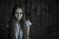 Horror girl in white dress Stock Photography