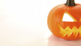 Horror halloween pumpkin, scary jack o lantern. Halloween scary horror pumpkin jack o lantern on white background, dolly shot, close up stock footage