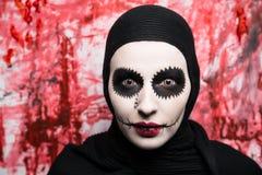 Horror make up. New creative make-up, conceptual idea for horror Halloween night party. White black color skull, tears, anatomy shape bones, cosmetics shadows Stock Image