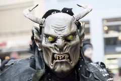 Horror Mask with horns and fang at carnival royalty free stock image