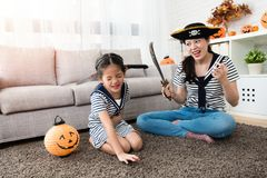 Horror mother play the killing game with her girl Royalty Free Stock Photo