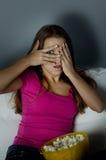 Horror movie. Woman watching scary horror movie Royalty Free Stock Photo
