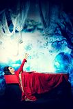 Horror movie. Bloodthirsty vampire woman lies in a coffin in the night cemetery Stock Images