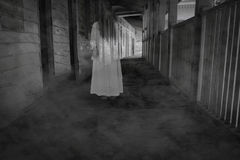 Horror movie scene with a lonely figure on the hall Stock Photos