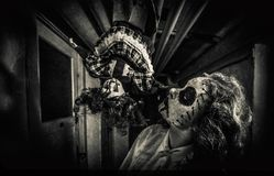 Horror movie scene. Of a scary woman with bloody doll Stock Photos