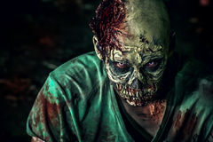 Horror movies. Close-up portrait of a horrible scary zombie man. Horror. Halloween Stock Image