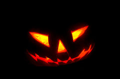 Horror pumpkin lighting in the dark Stock Images