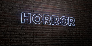 HORROR -Realistic Neon Sign on Brick Wall background - 3D rendered royalty free stock image Royalty Free Stock Photography